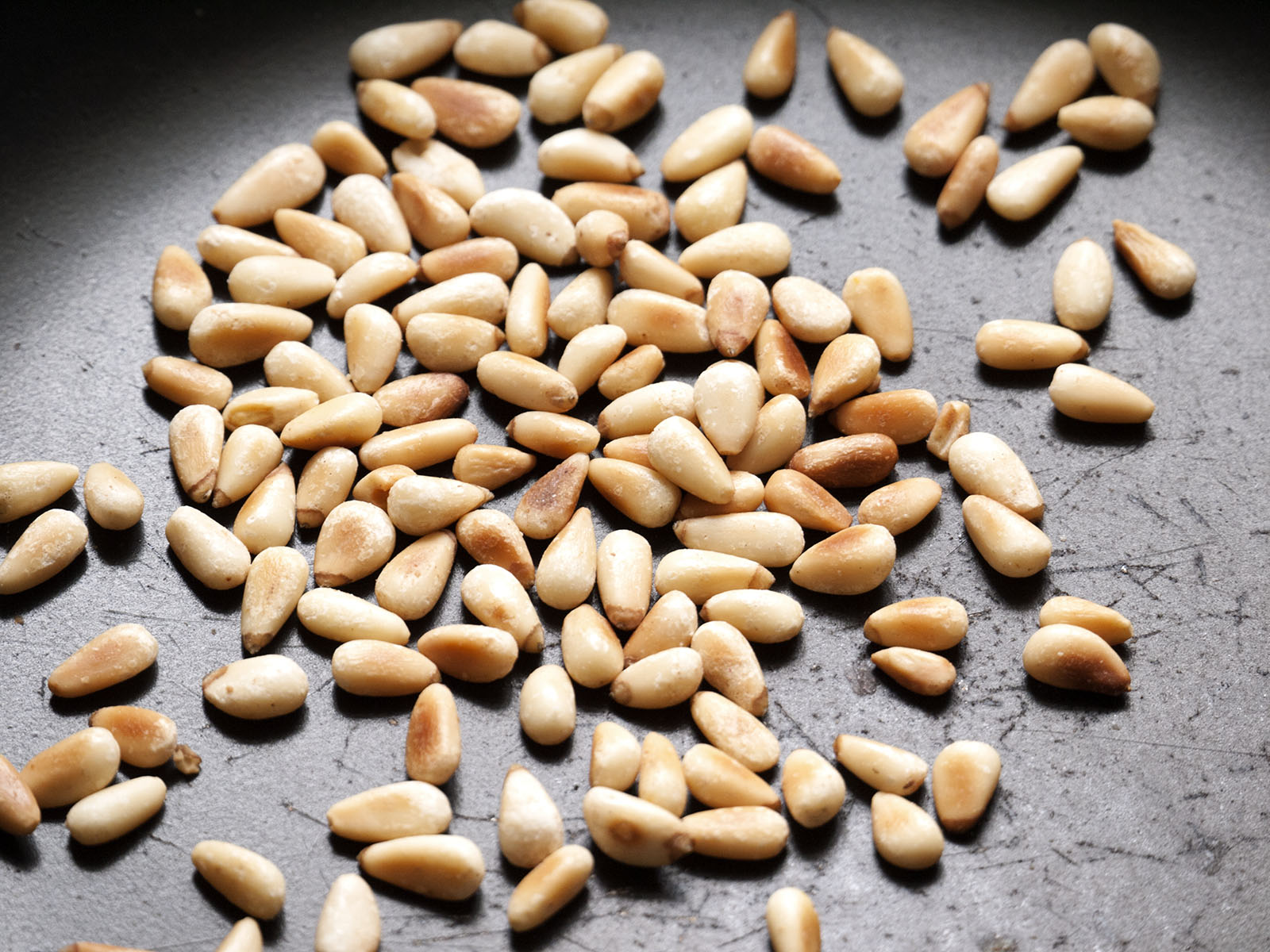 Pine nuts in frying pan