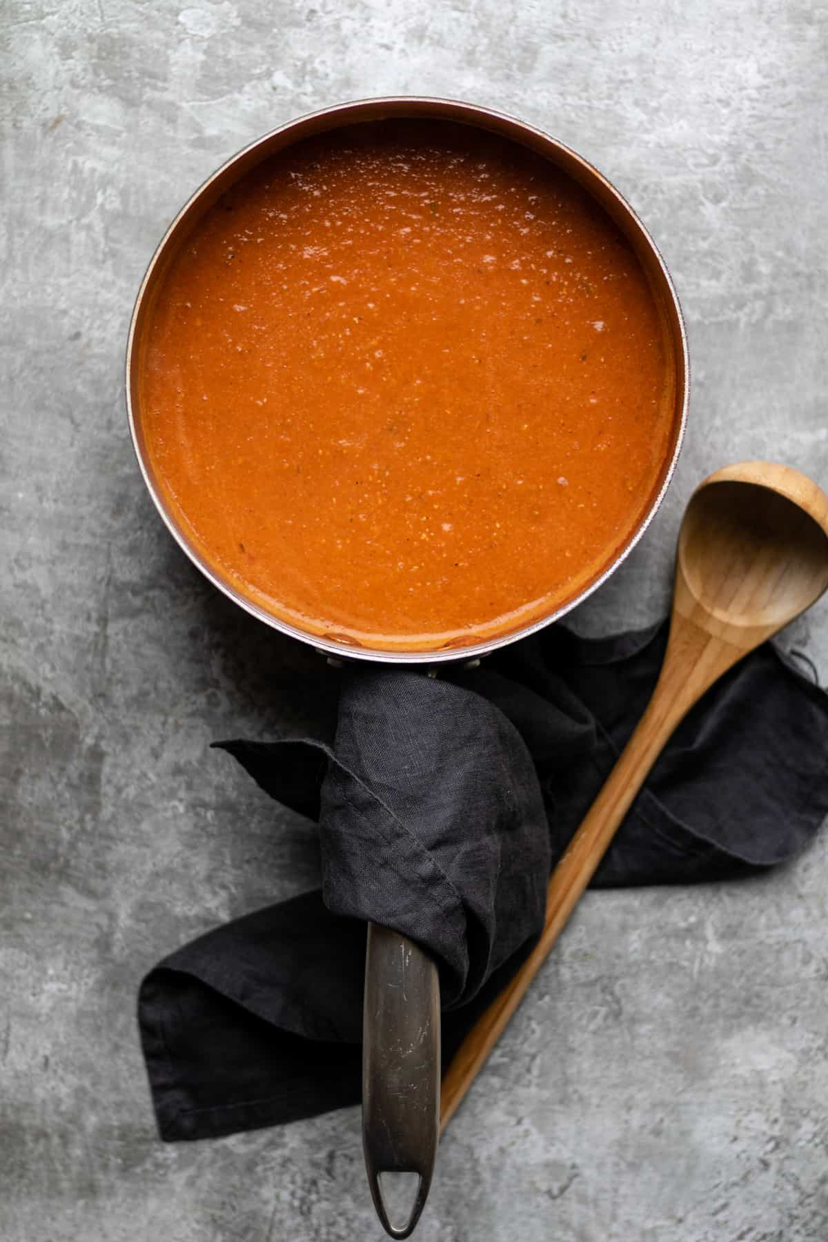 Spicy tomato soup in saucepan