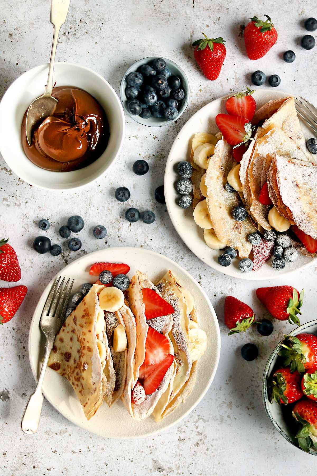 Pancakes with banana, strawberries, blueberries and Nutella filling