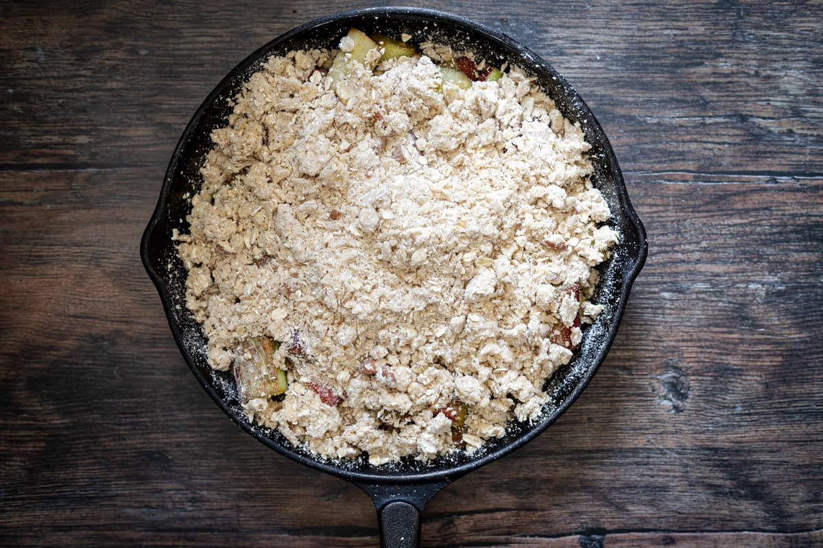 crumble covering rhubarb in a skillet