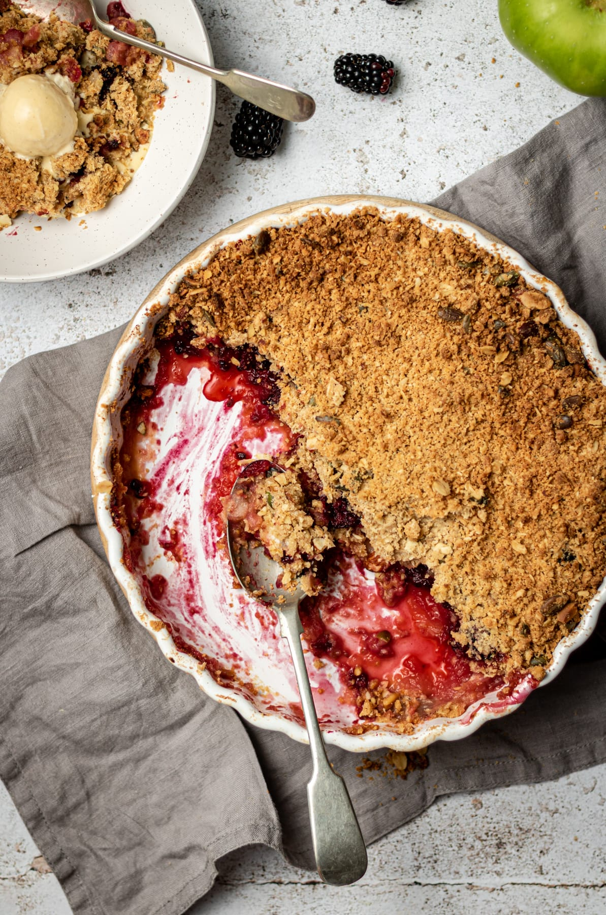 Crumble in pie dish with spoon