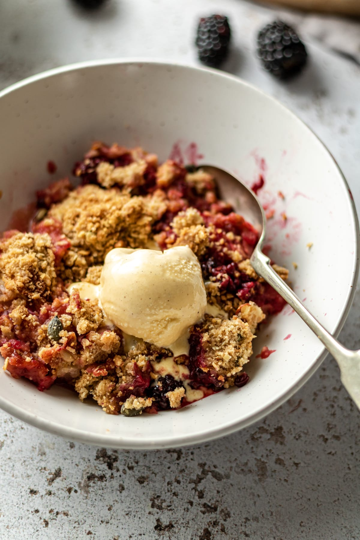 Crumble in a bowl with a scoop of ice cream
