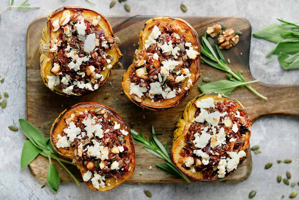 Harlequin Squash stuff with wild rice with crumbled feta, walnuts and pumpkins seed with sage and rosemary.