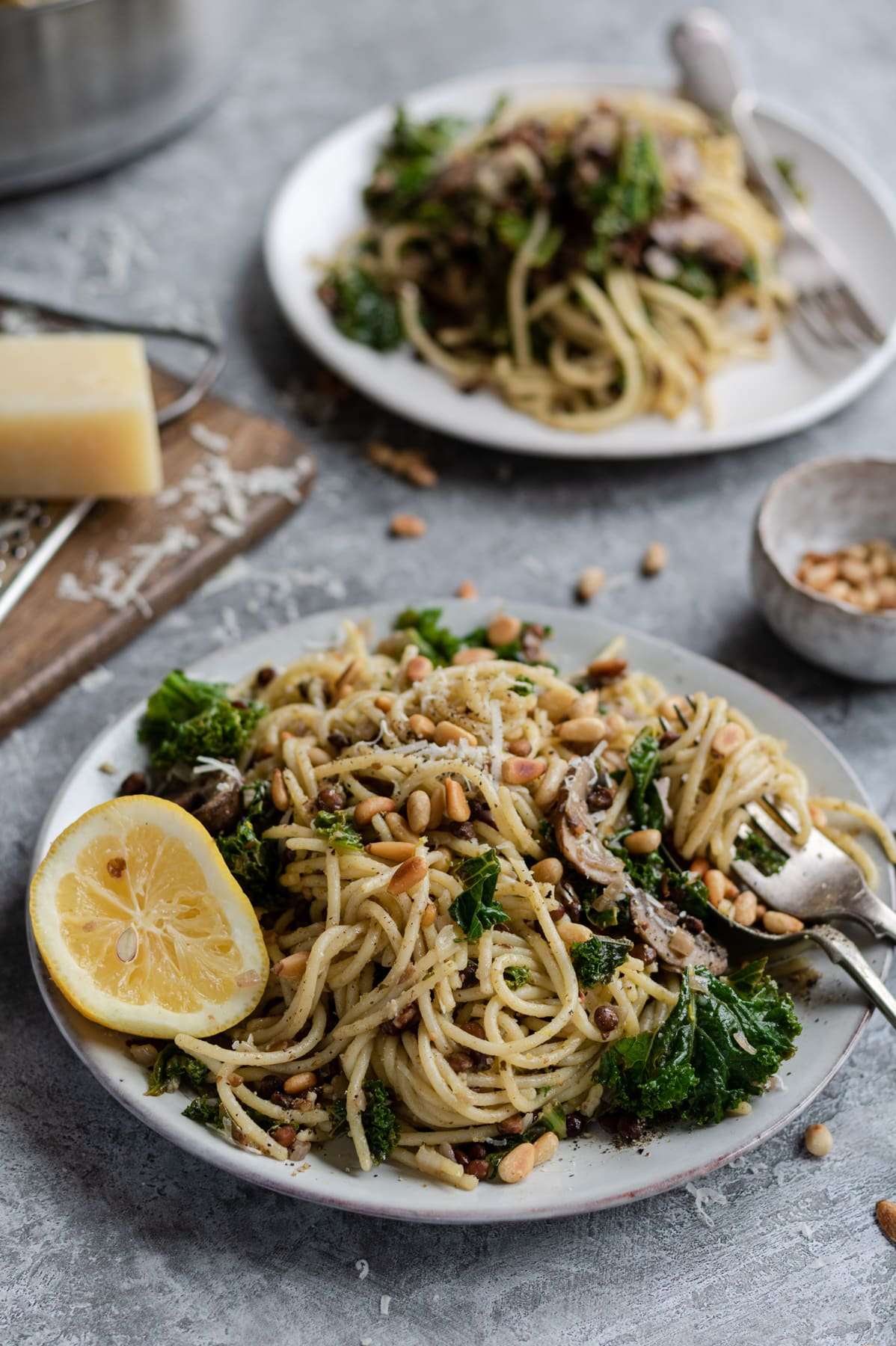 spaghetti with mushrooms, sprinkled with pine nuts and parmesan