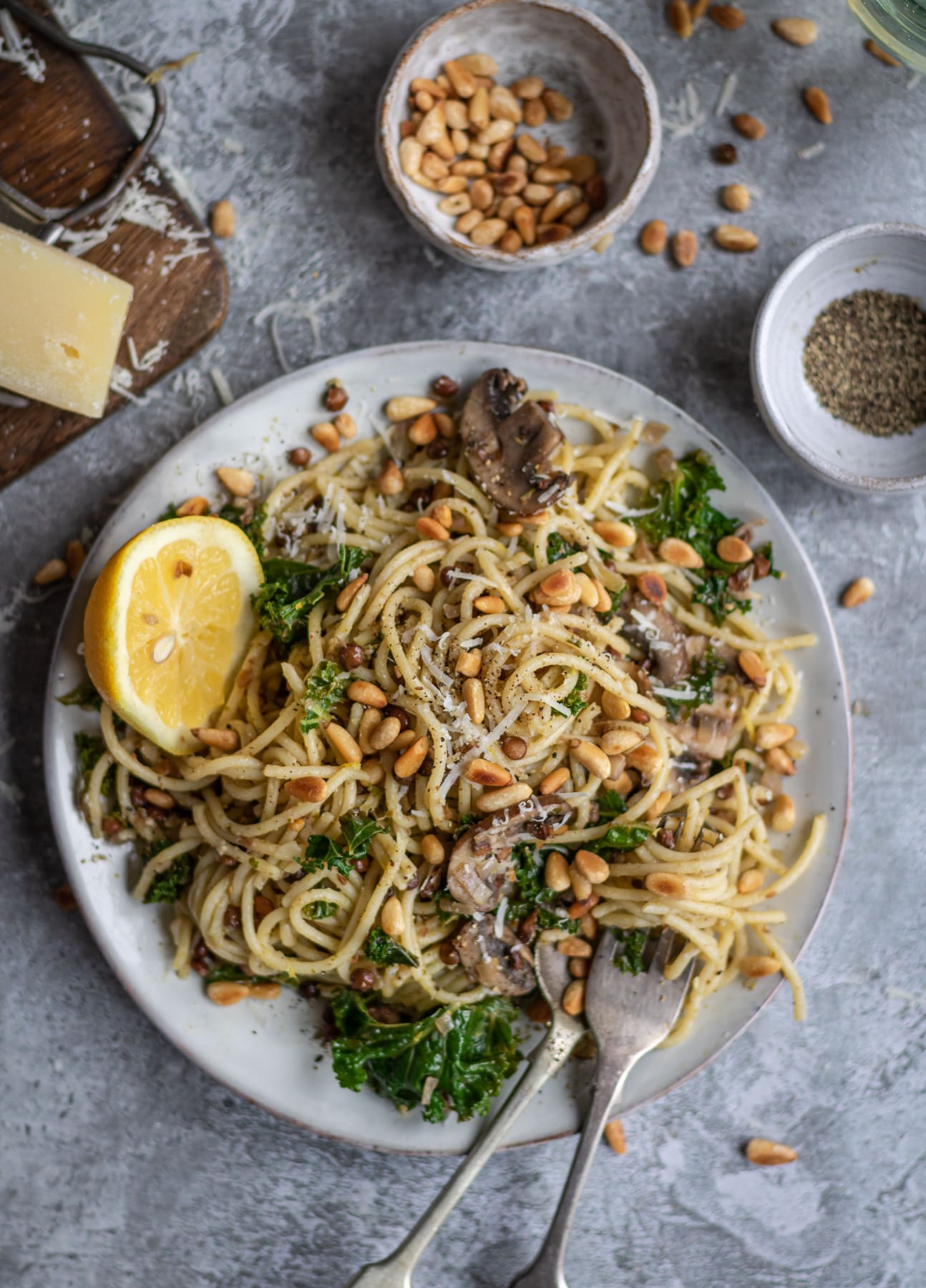 spaghetti sprinkled with pine nuts and kale