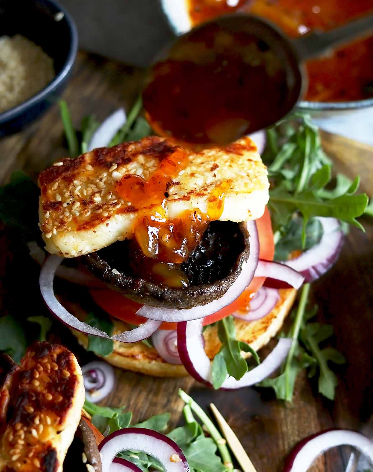 Halloumi, with mushrooms, topped with red onion, rocket, coriander and spicy mango chutney in a brioche bun.
