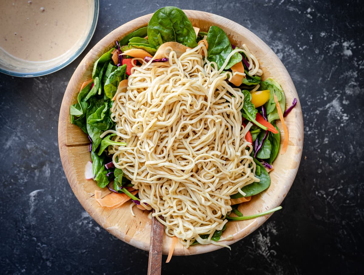 Noodles on top of vegetables in a bowl