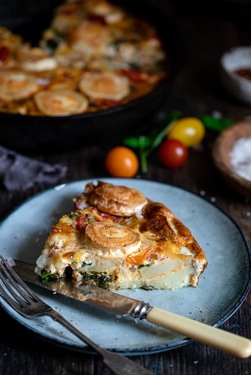 Frittata with Spinach, cheese, potatoes and Tomatoes on a plate