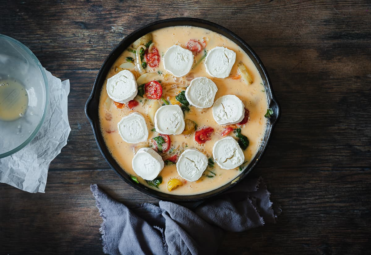 eggs with goats cheese with other ingredients in skillet