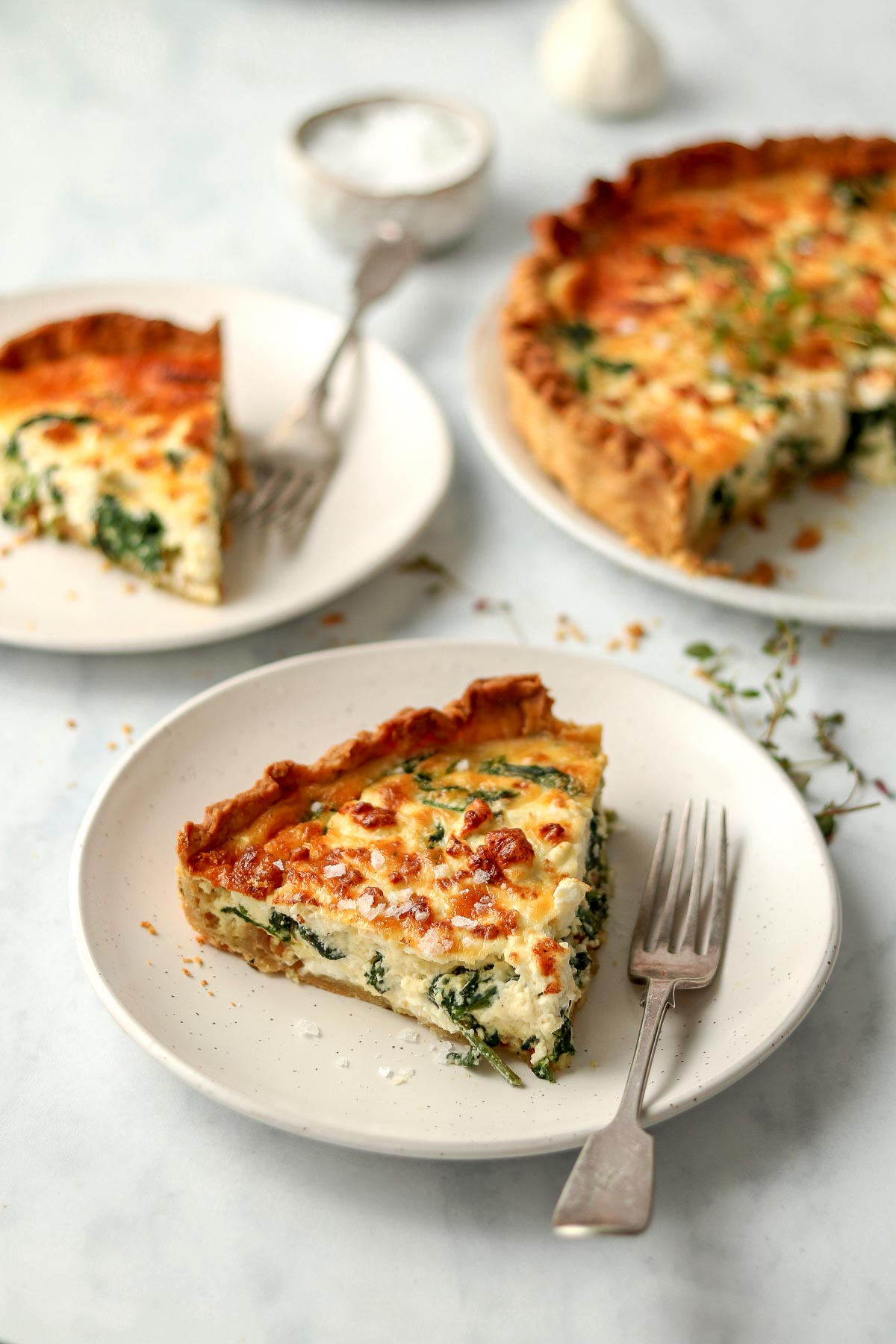 Slice of quiche on plate