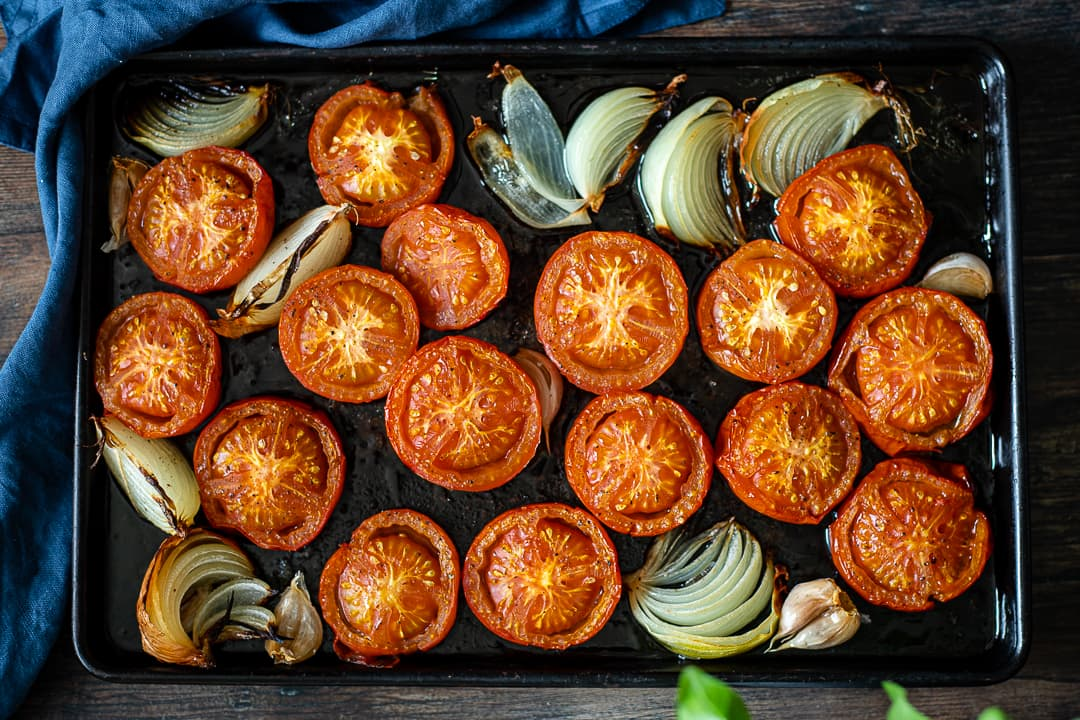 Tomatoes and onions on a baking tray