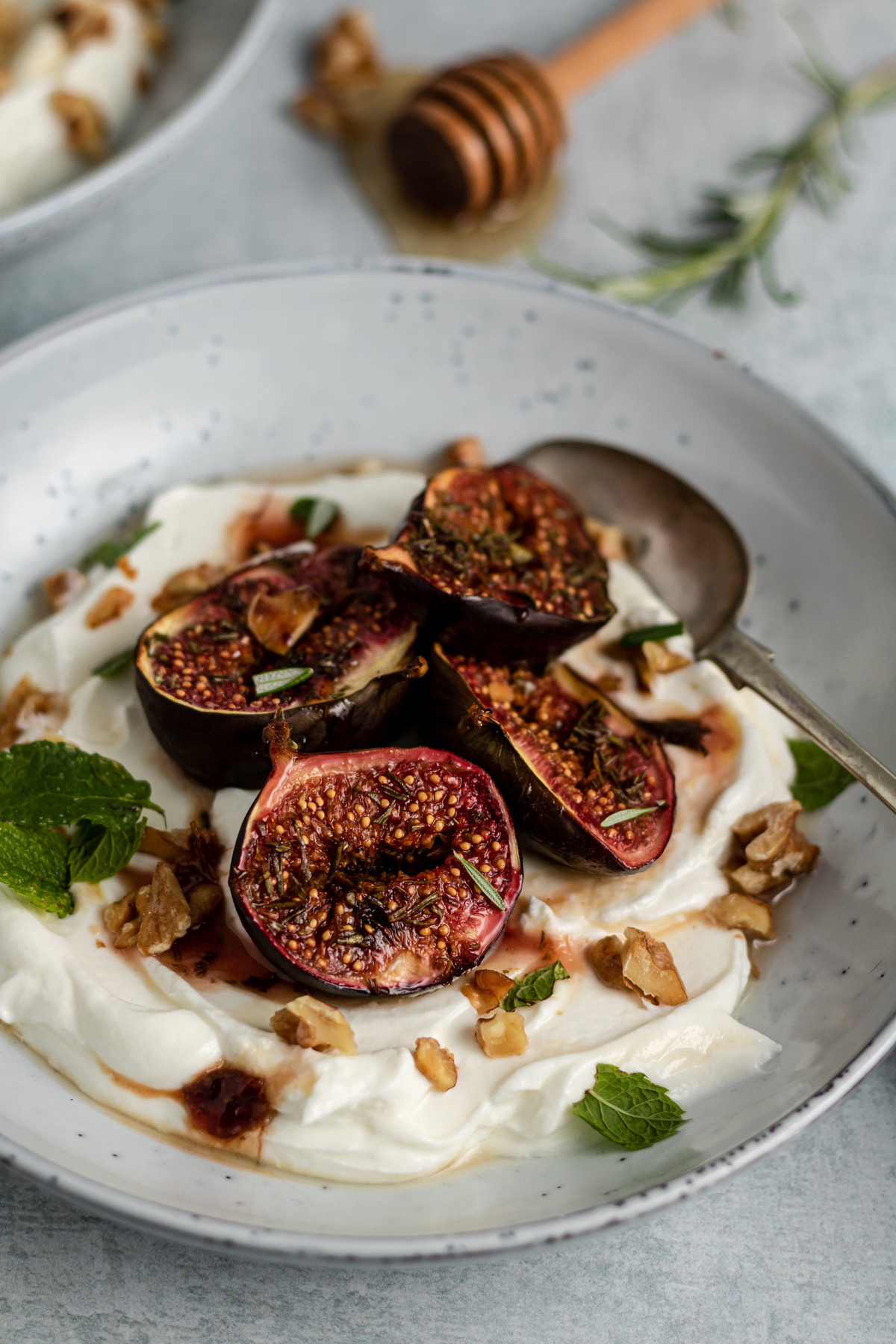 close up photo of roasted figs in a bowl