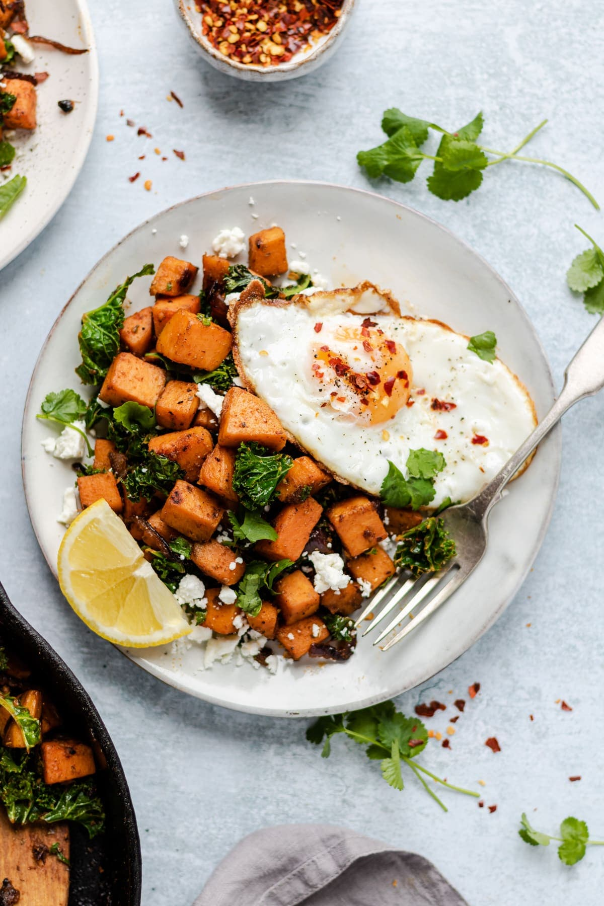 Sweet potatoes and kale with crumbled feta topped with a fried egg
