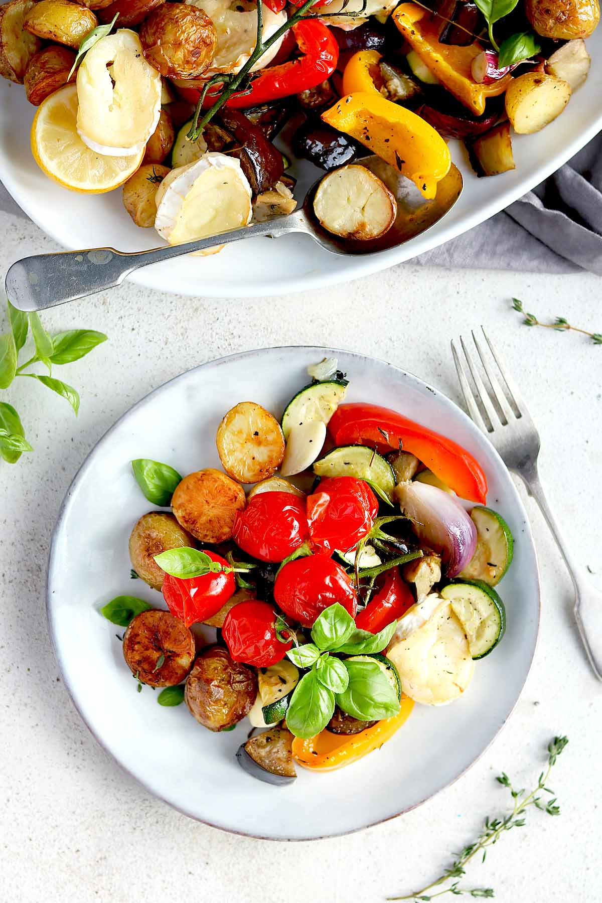 Roasted vegetables with goats cheese, potatoes, roasted garlic, cherry vine tomatoes and basil
