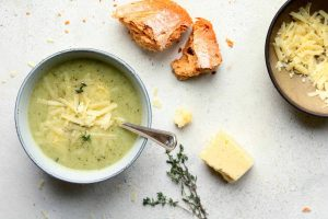Creamy Broccoli and Cauliflower Soup with grated cheese