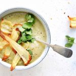 Curried Parsnip Soup served with parsnip crisps and coriander garnish