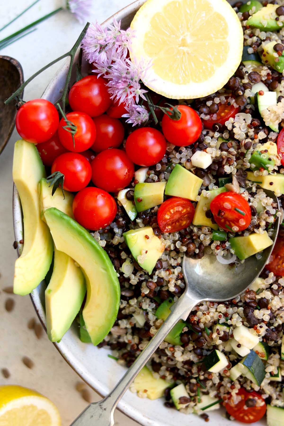 Quinoa salad in bowl with spoon