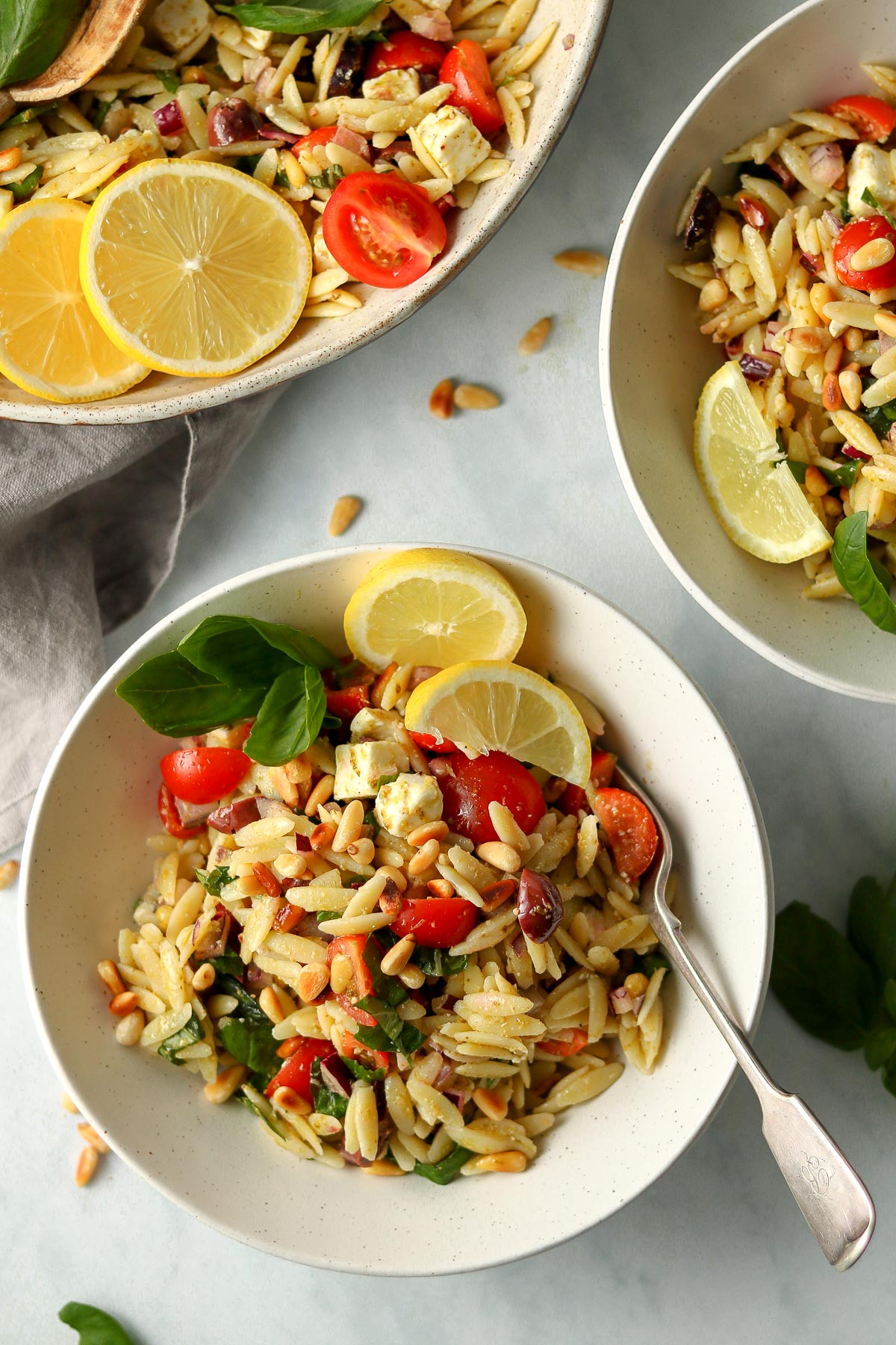 Close up of orzo pasta salad in serving bowls