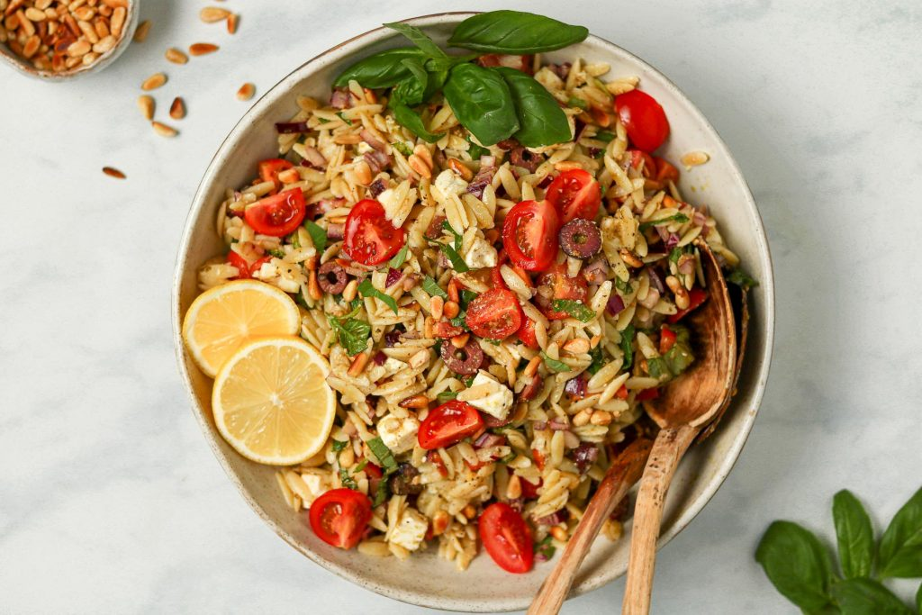 Overhead photo of orzo pasta salad in serving dish