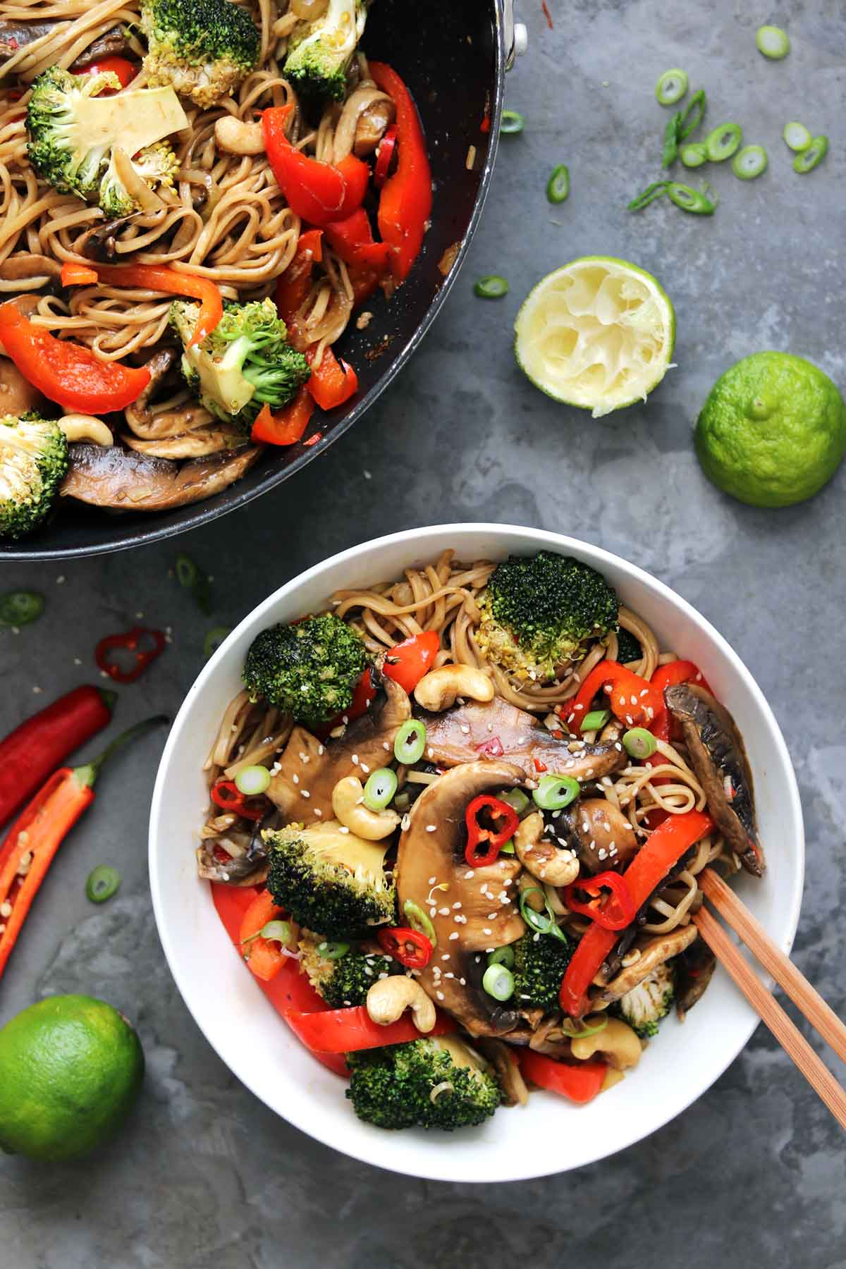 mushrooms and broccoli with spring onion, chilli and noodles and lime slices