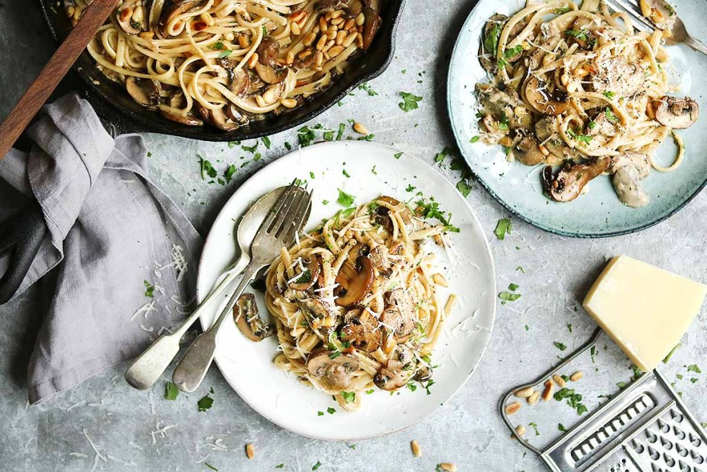 Pasta with Mushrooms, Parmesan, Pine Nuts and a Thyme and parsley garnish.