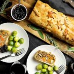 Nut roast wrapped in a pastry with Brussels Sprouts, Cranberry Sauce, with rosemary and sage.