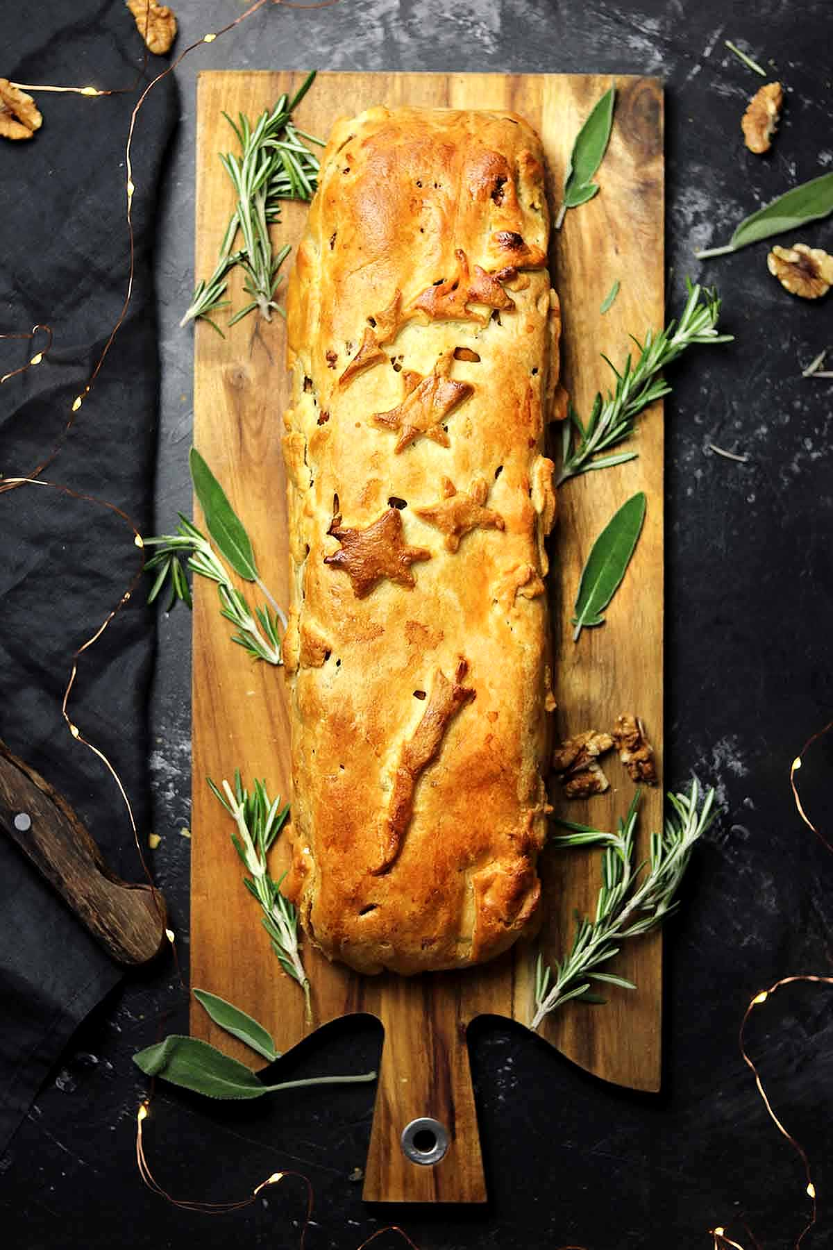 Nut roast wrapped in a pastry with rosemary and sage.