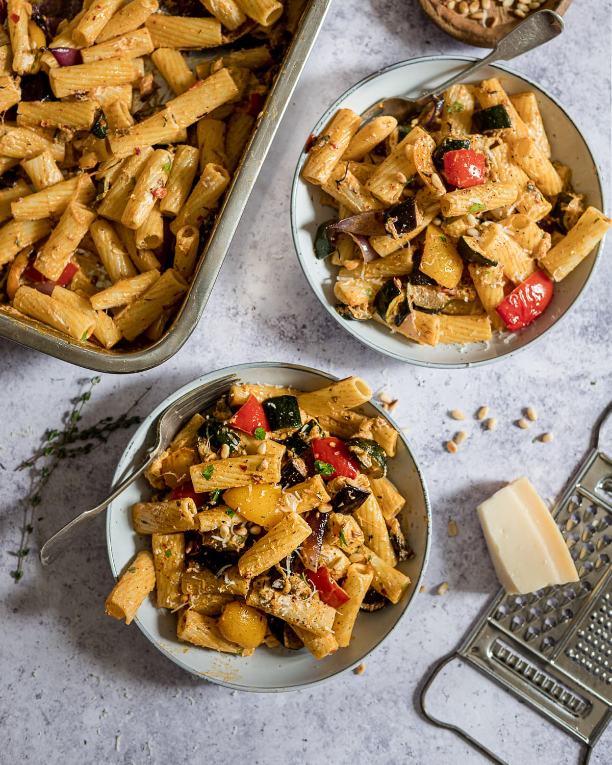 Pasta with courgette, aubergine, peppers, inion and pine nuts