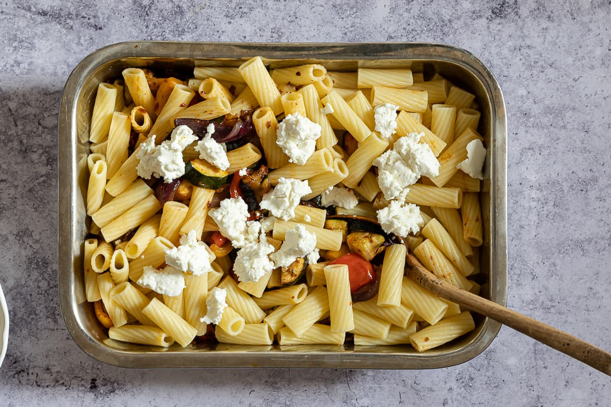 Pasta with goats cheese in tray