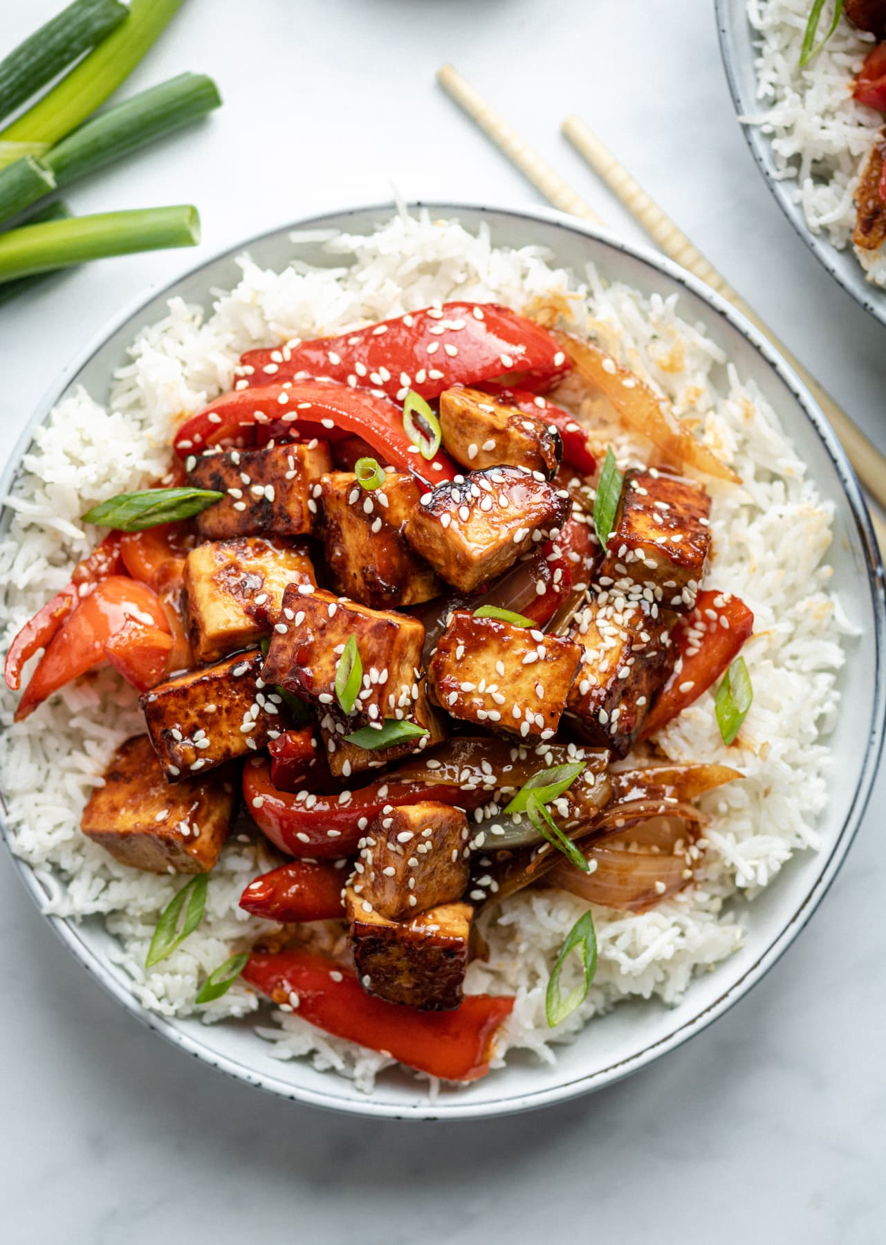 Tofu, peppers and onions, served with white rice