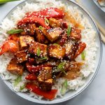 Tofu with Sesame seeds, peppers and onions, served with white rice