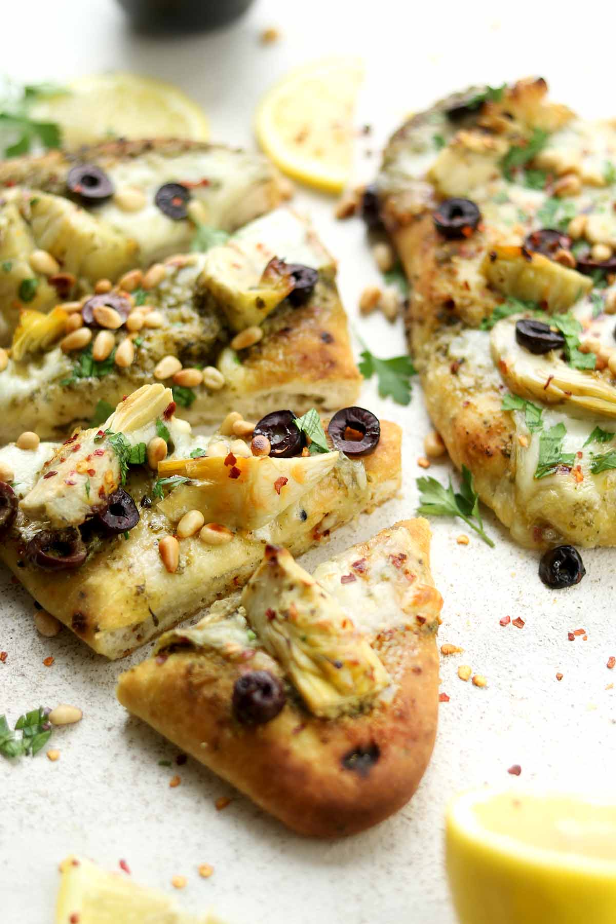 Artichoke & Olive Naan Pizza cut into slices close up