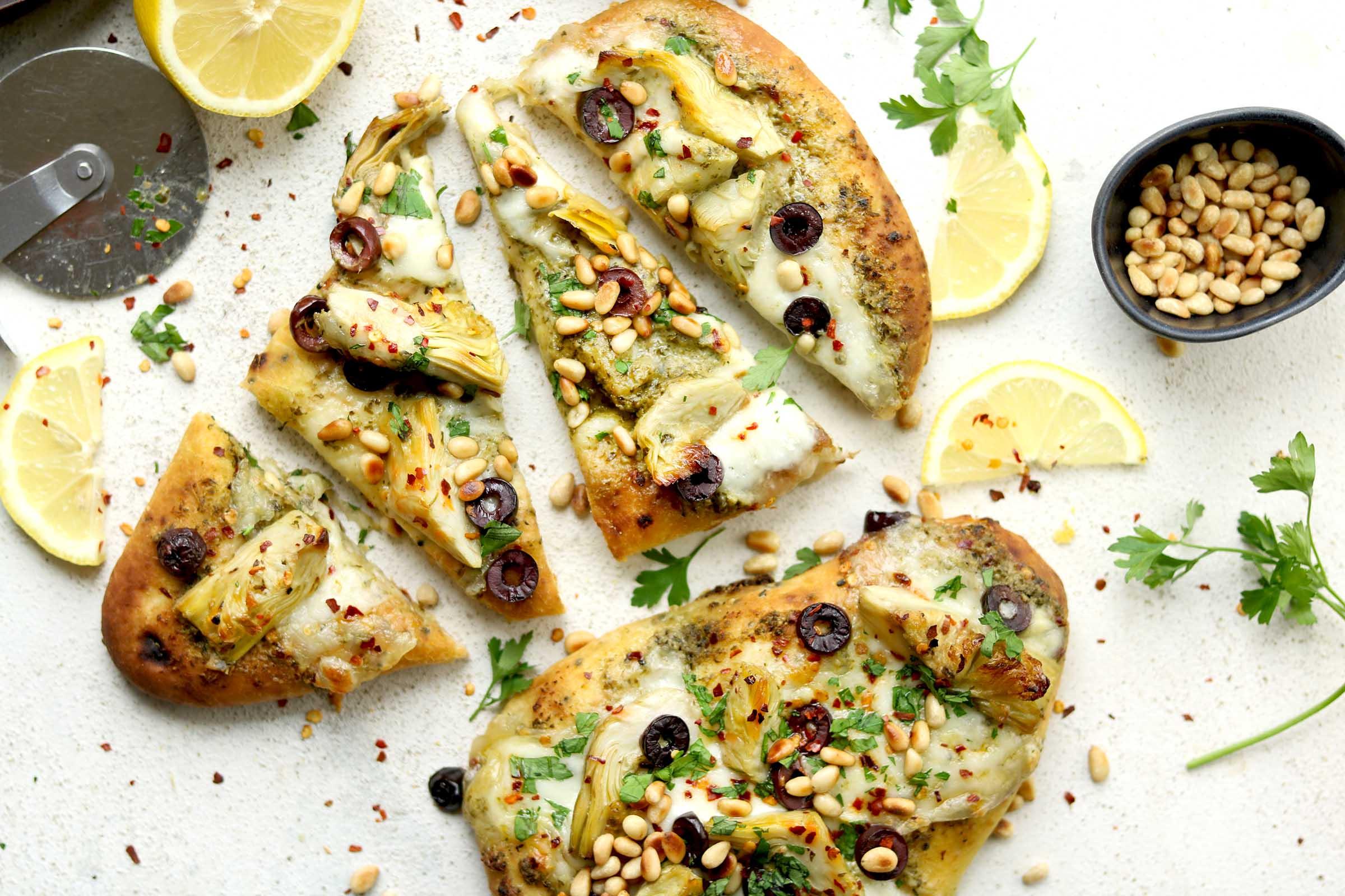 Artichoke & Olive Naan Pizza cut into slices landscape