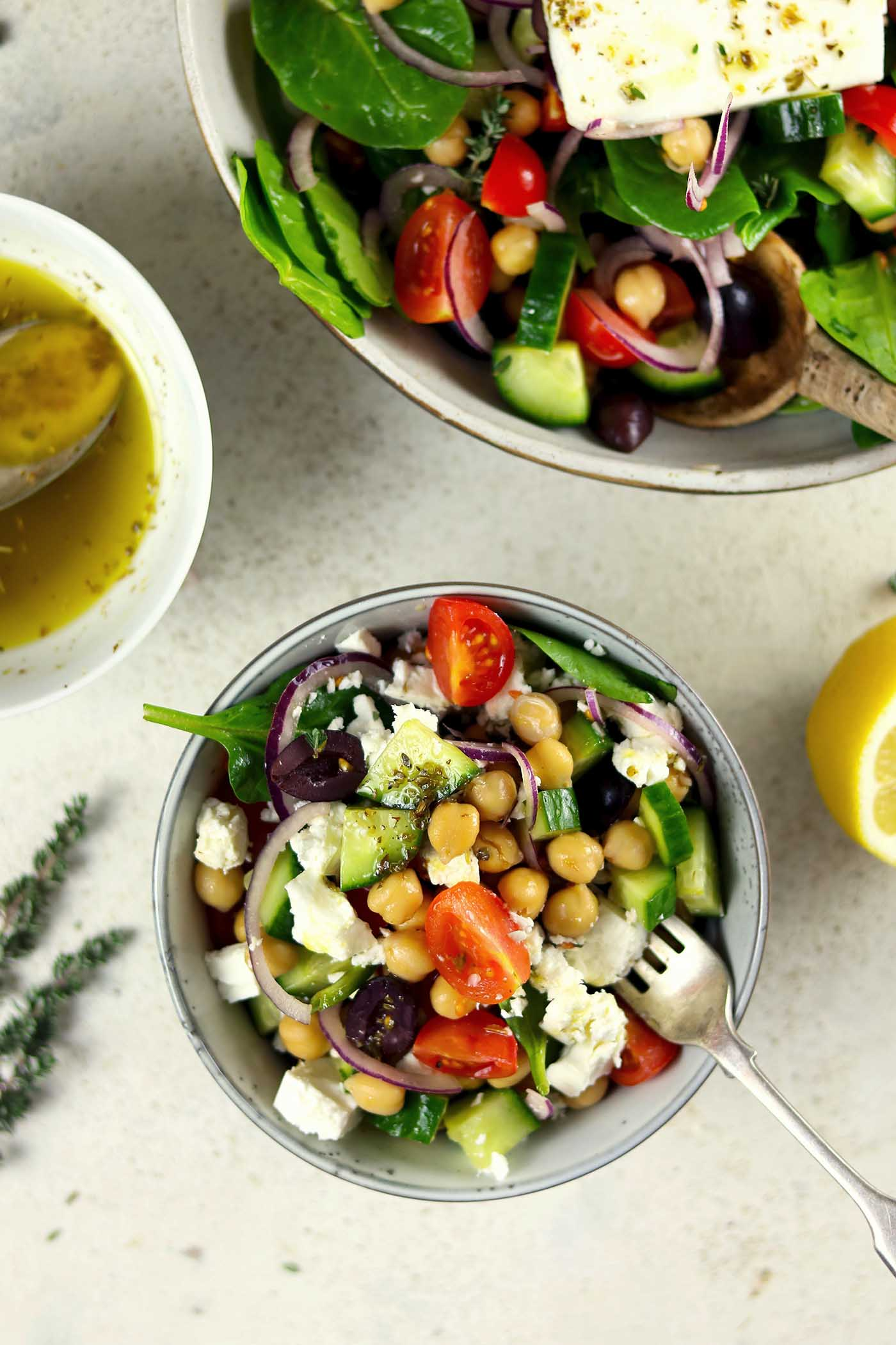 Greek Chickpea Salad with Spinach served in bowl