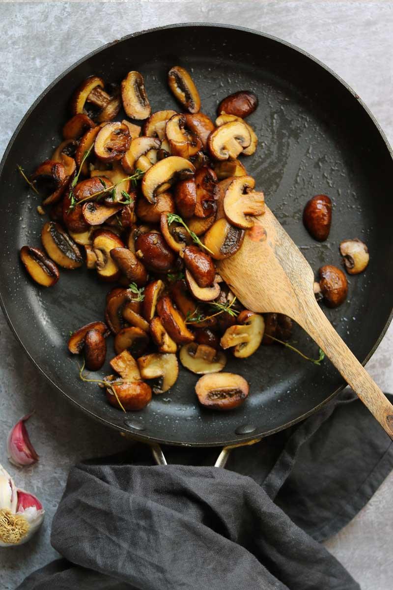 cooked mushrooms in saucepan