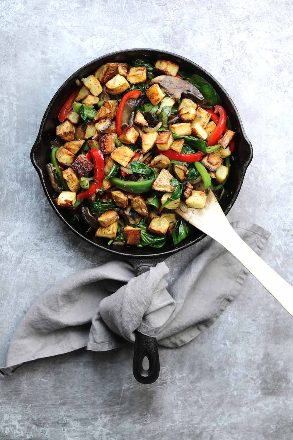 skillet with vegetables with potatos