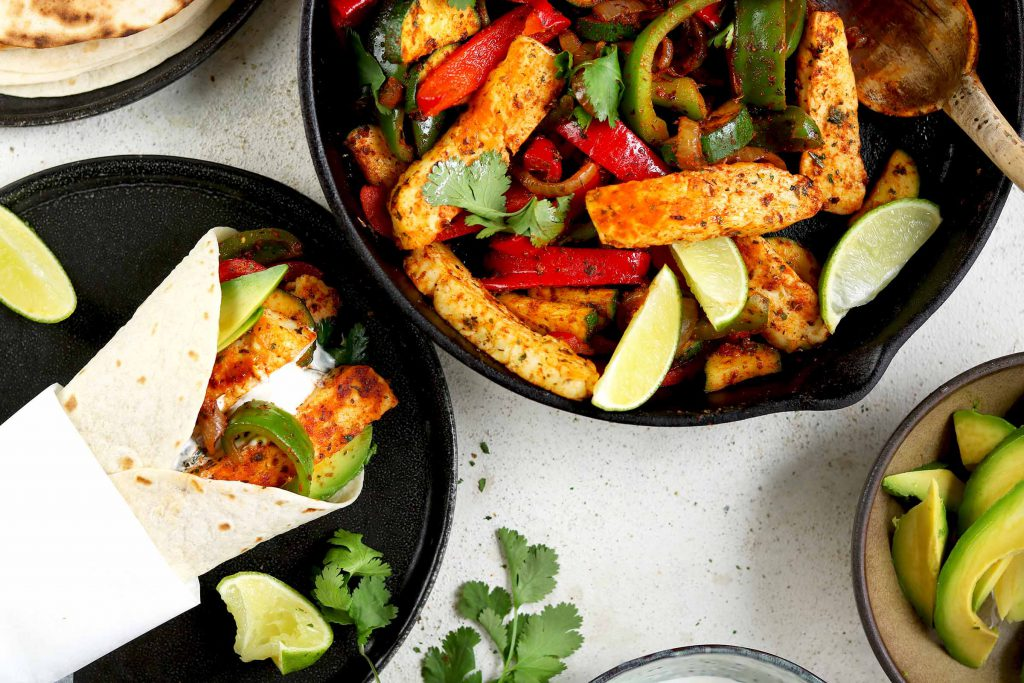 halloumi fajitas with peppers served in a wrap