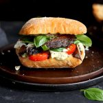 portobello mushroom sandwich with basil on a plate
