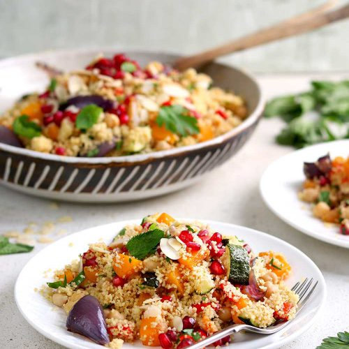 Moroccan Couscous with roasted vegetables and chickpeas and herbs in a serving dish