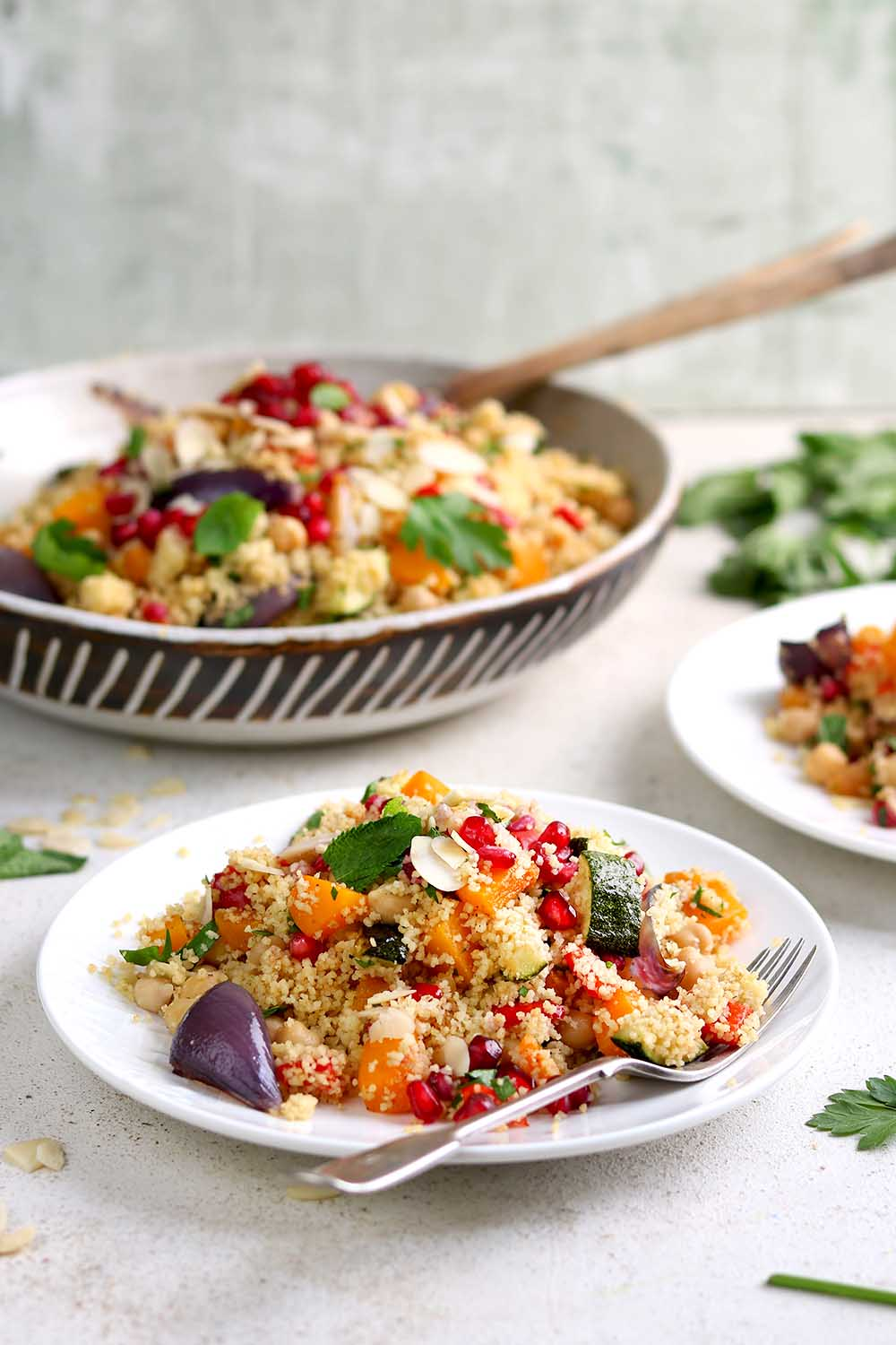 Couscous with roasted vegetables and chickpeas and herbs in a serving dish