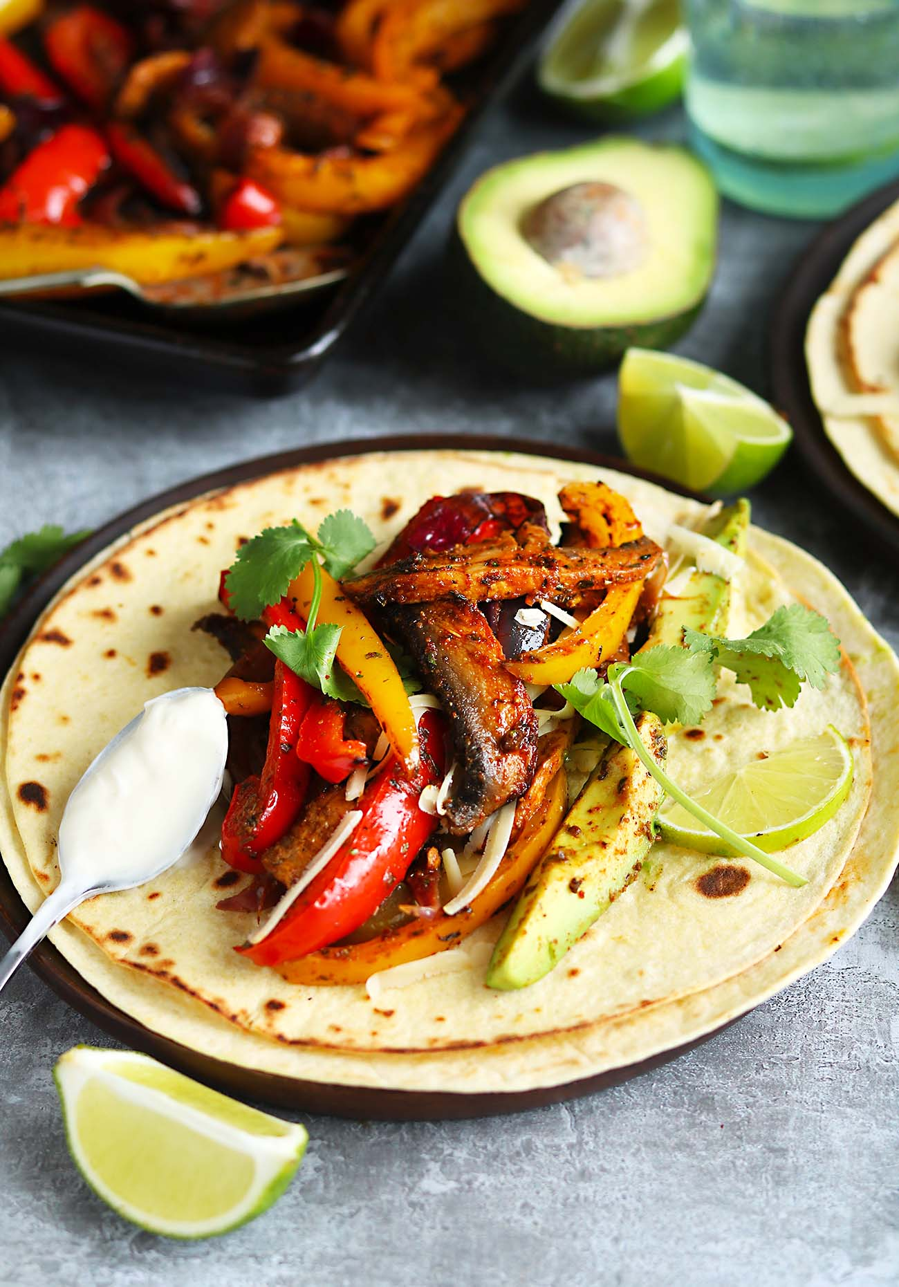 Mushrooms with peppers, avocado and coriander, in a tortilla with cheese and sour cream.