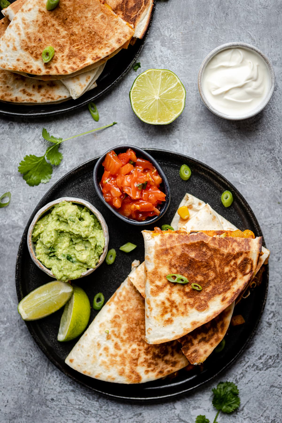 Tortillas with Sweet Potato, black beans, filled with cheese and an avocado dip