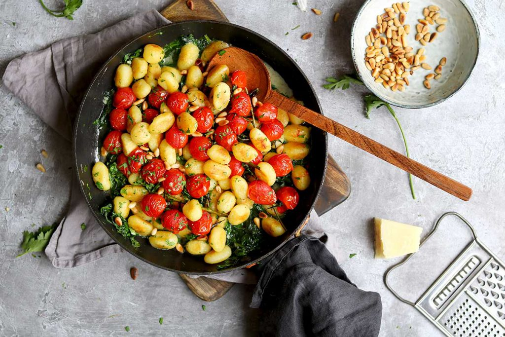 Gnocchi with Spinach, Roasted Cherry Tomatoes, parmesan and pine nuts