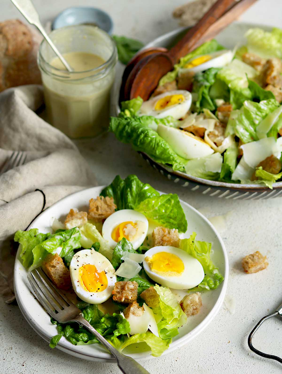 Romaine lettuce, eggs, croutons and Vegetarian Parmesan in a salad dressing.
