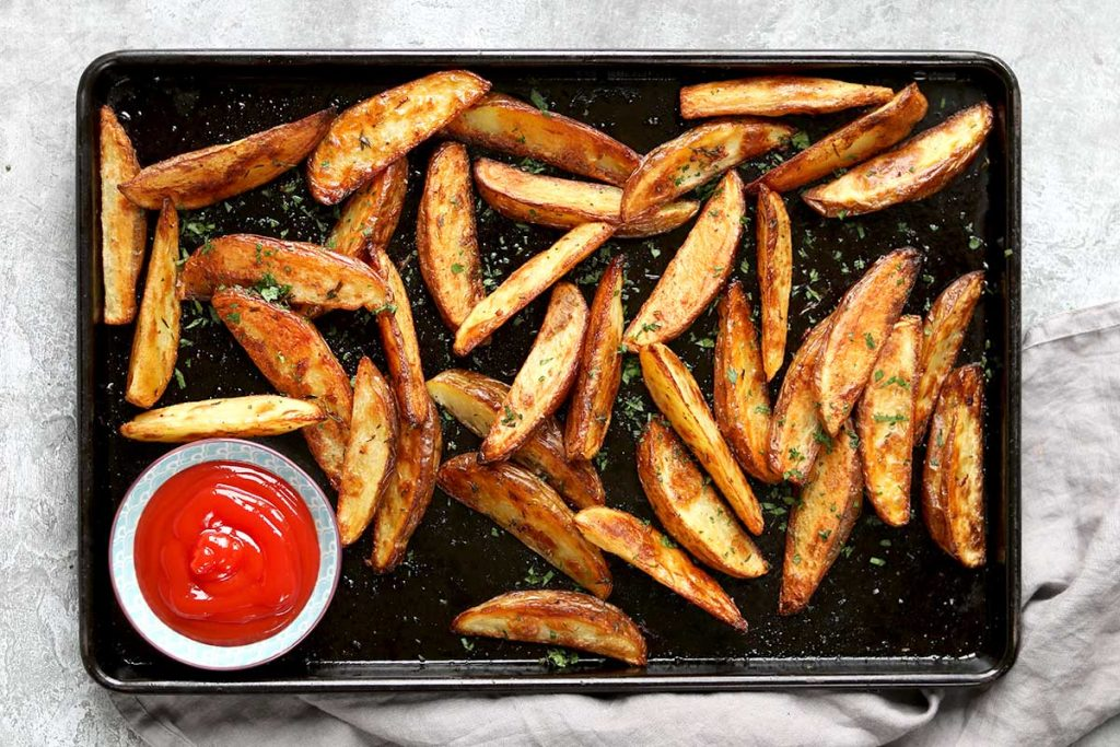 Baked Potato Wedges with herbs and tomato ketchup