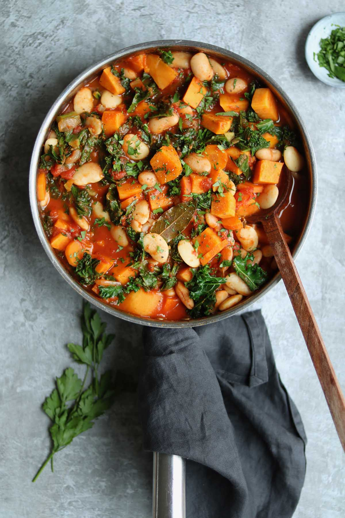 Butter beans with carrots, kale and sweet potatoes in tomato sauce.