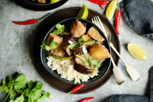 A Massaman Curry with green beans, waxy potatoes, aubergine and chillies, served with rice and coriander