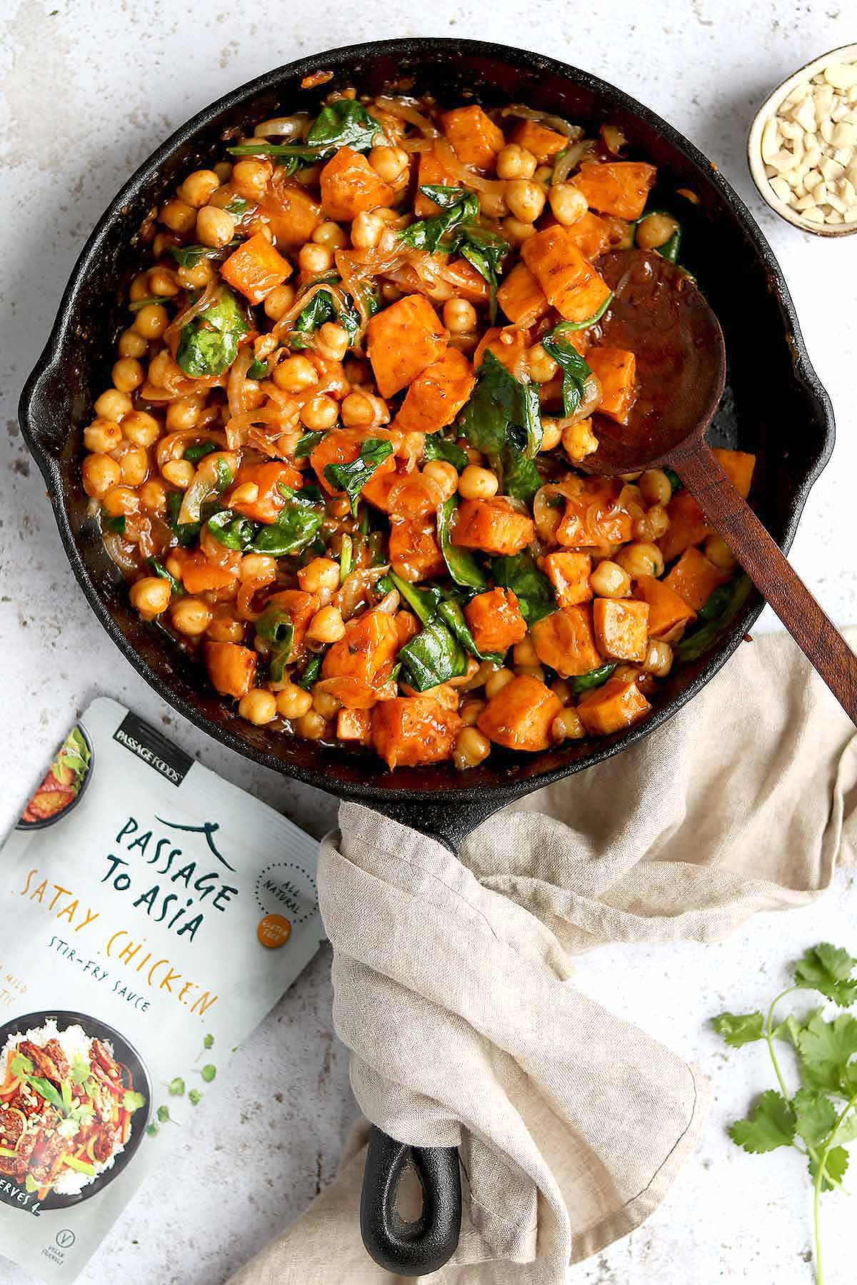 Sweet Potatoes, in a Satay Curry Sauce with Chickpeas and Spinach, served with rice and a Coriander garnish.