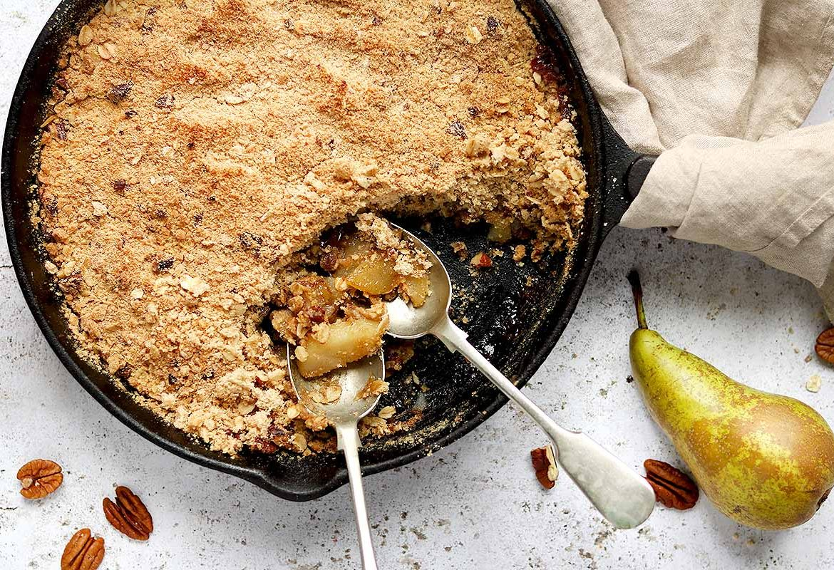 Pears with ginger in a tasty caramel sauce topped with a buttery pecan and oat topping.