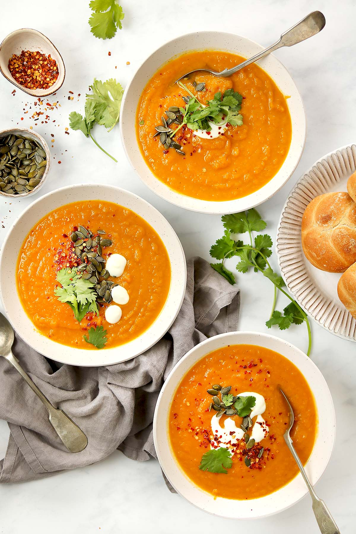 Sweet Potato and Carrot Soup with coriander garnish, pumpkin seeds and yoghurt dressing